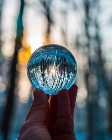 photo of person holding crystal ball